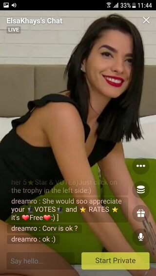 Sexy webcam model has red lipstick and a killer smile